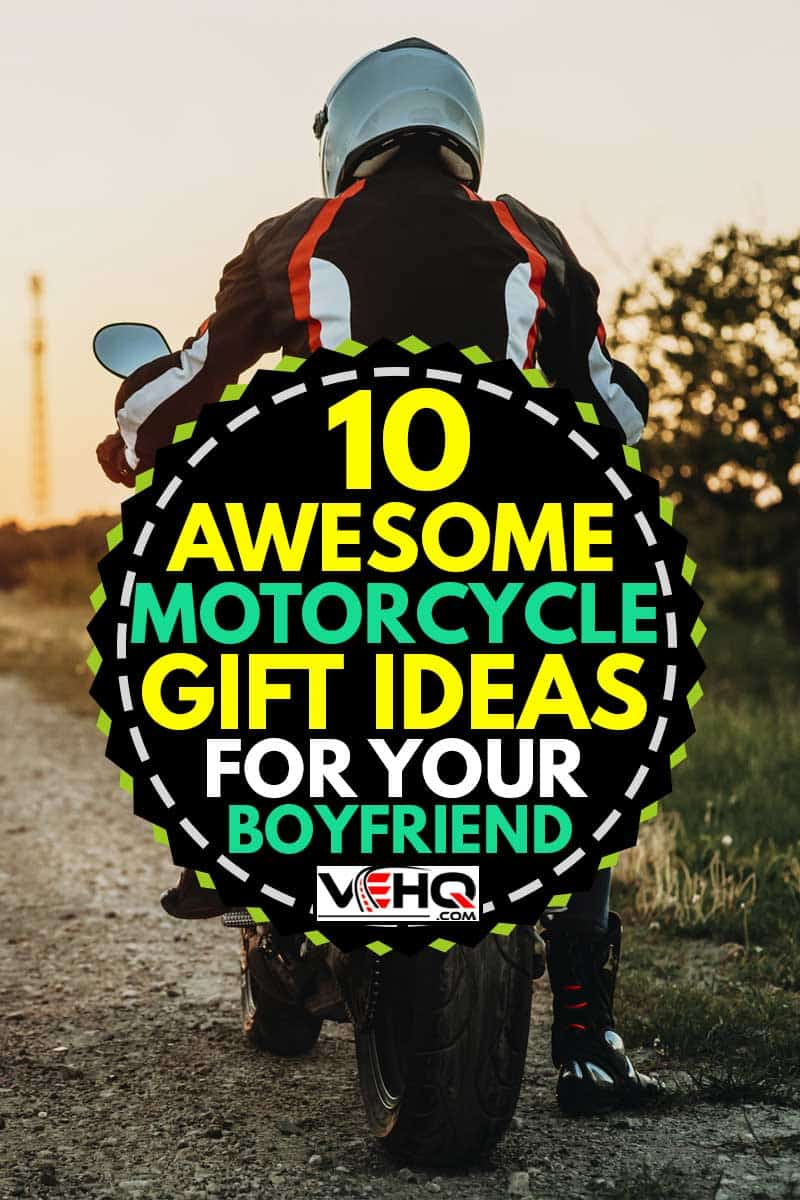 Back view of male in protective jacket, boots and helmet riding off roadside at sunset on empty highway backlit background, 10 Awesome Motorcycle Gift Ideas For Your Boyfriend