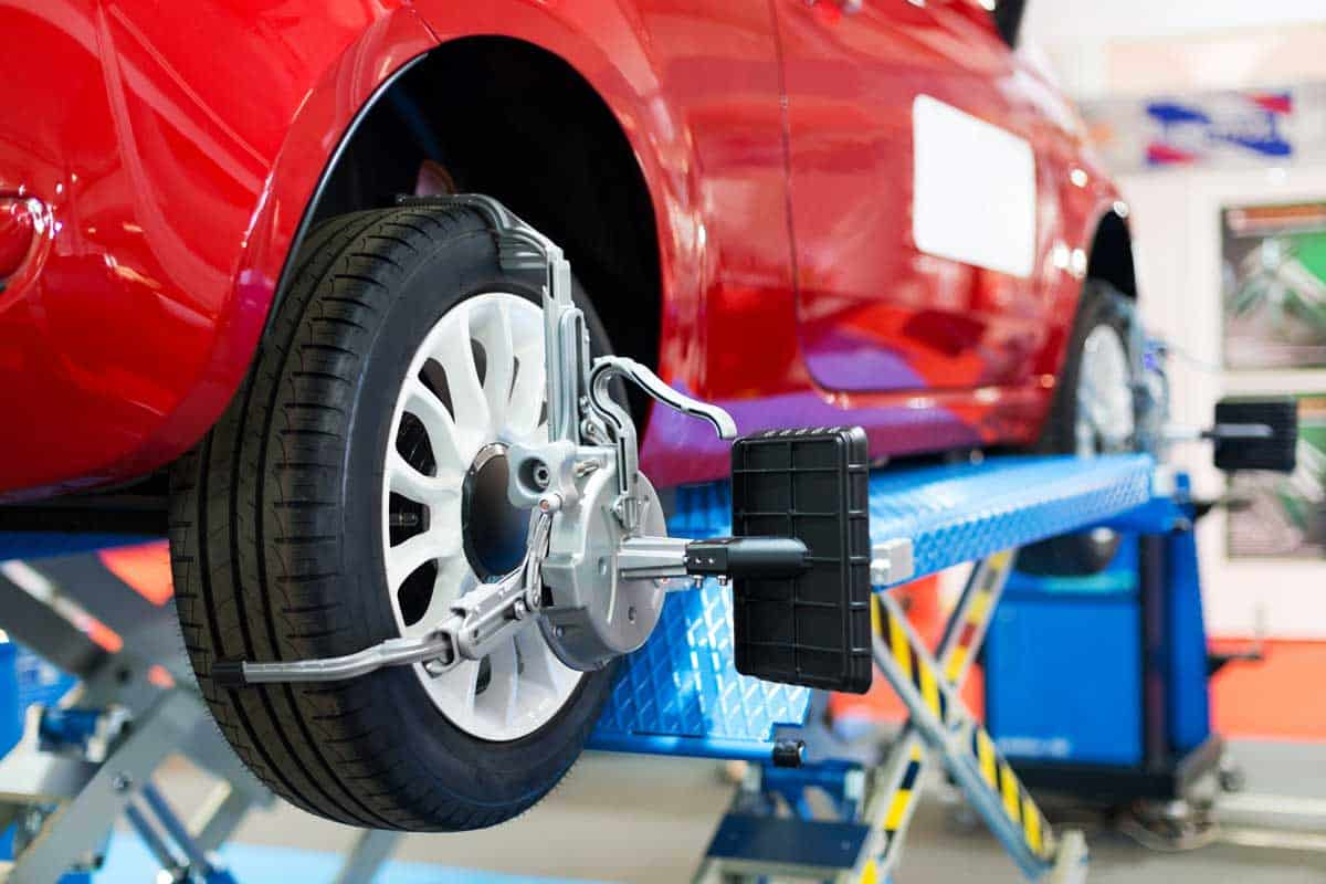 Caster angle of wheel alignment at auto repair shop