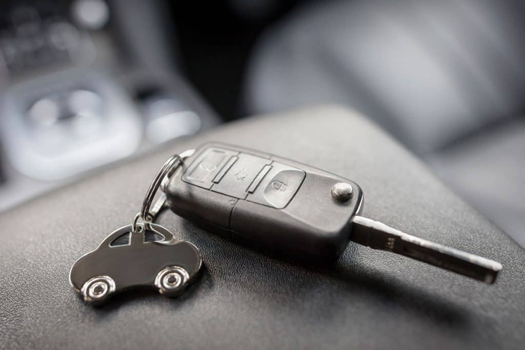Close up image of a car key fob, How To Start A Push-Start Car?