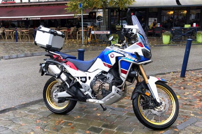 Honda Africa Twin motorcycle parked by the side, Can a Motorcycle be Automatic?