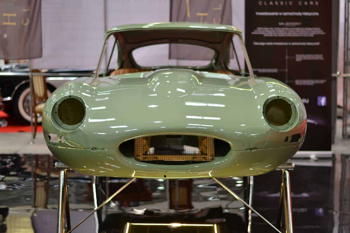 The presentation of car body of classic Jaguar E-Type during the restoration process.