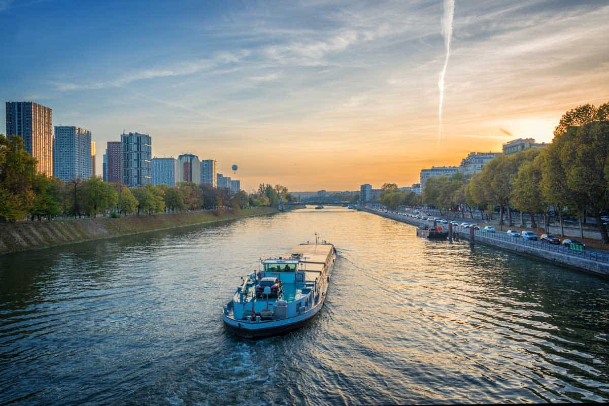 Barge on the river Seine at sunset, Paris France