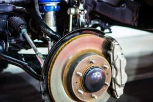 Car disc brake and blue shock absorber, What is Brake Assist in Cars? [What every driver NEEDS to know]