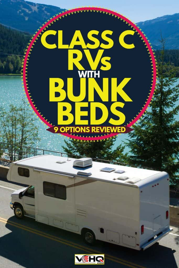 An RV moving down the road near Green Lake in Whistler, BC, Class C RVs with Bunk Beds [9 Options Reviewed]
