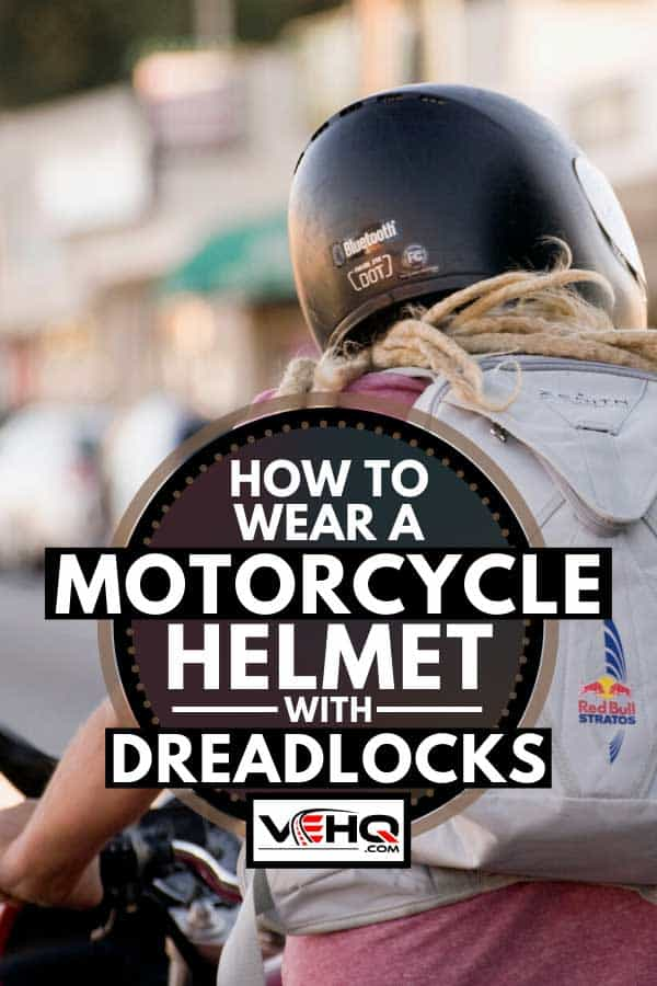 Motorcycle rider with a dreadlocks crossing a busy intersection, How to Wear a Motorcycle Helmet with Dreadlocks