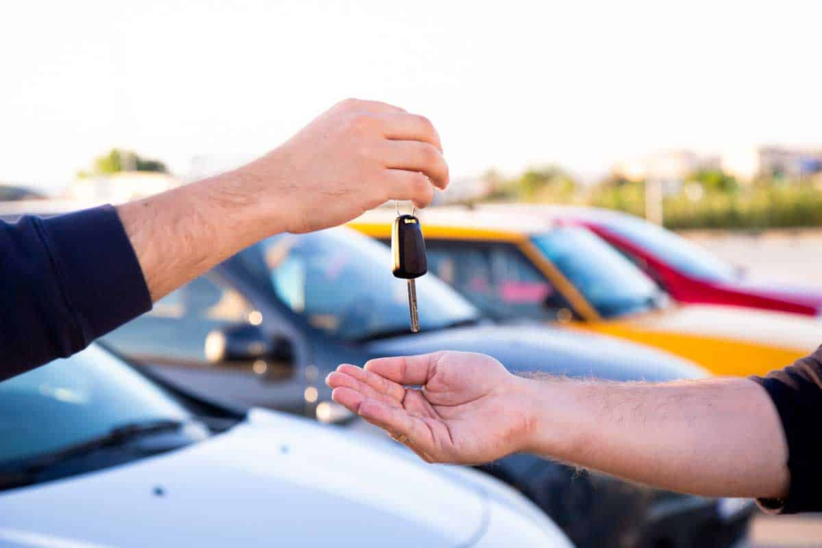 A man investing his money on a new car. What Is The Best Month To Buy A Car?