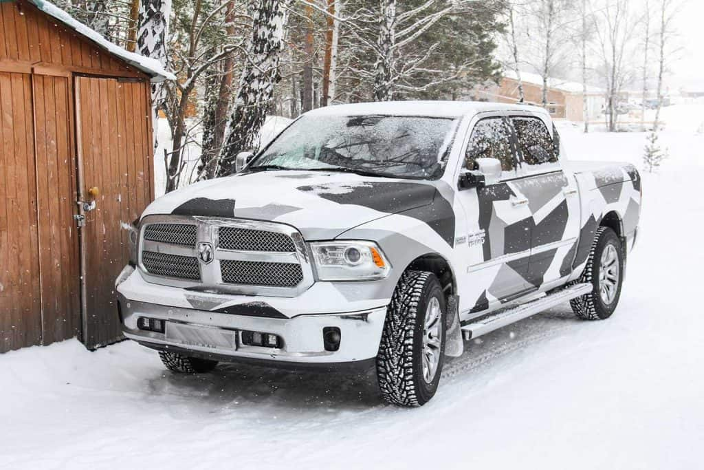 A Dodge Ram 1500 parked outside home during winter
