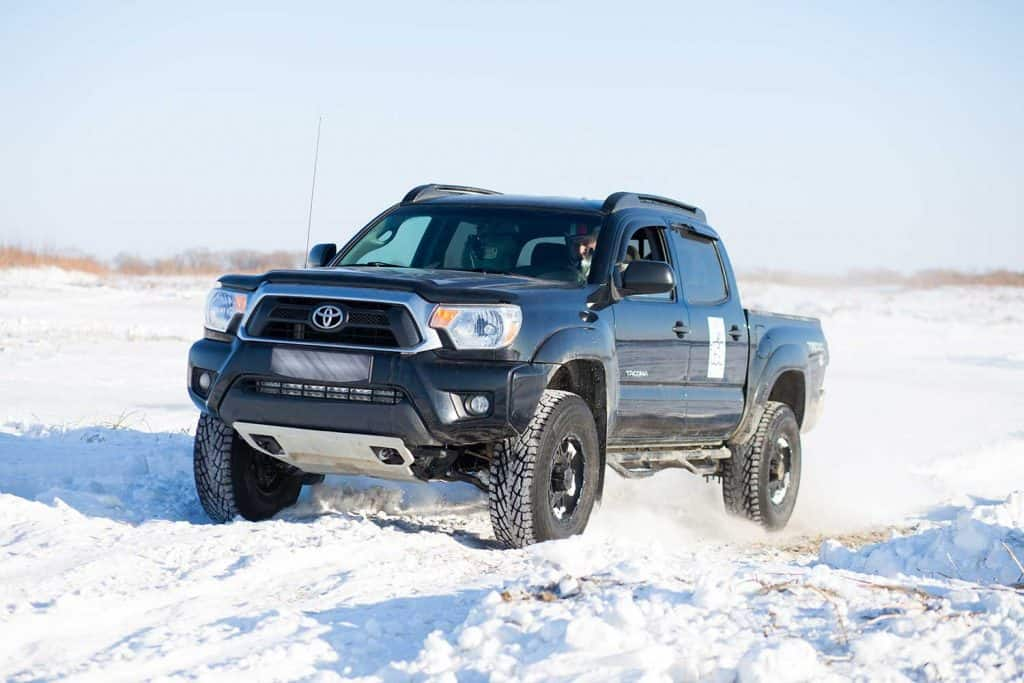 A Toyota Tacoma pickup truck on a snowy ground