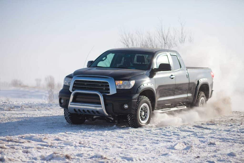 A Toyota Tundra pickup truck on a snowy ground