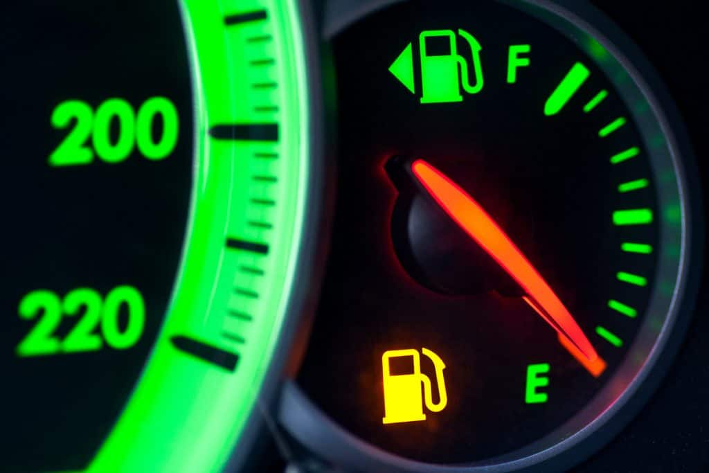 A close up photo of a gas gauge pointed at empty