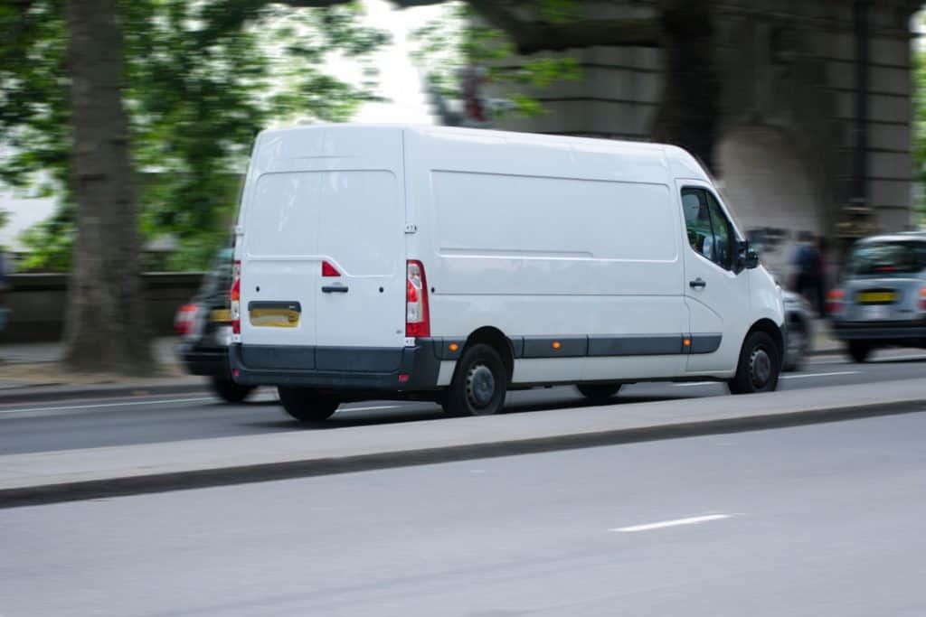 A full sized van moving on the city road