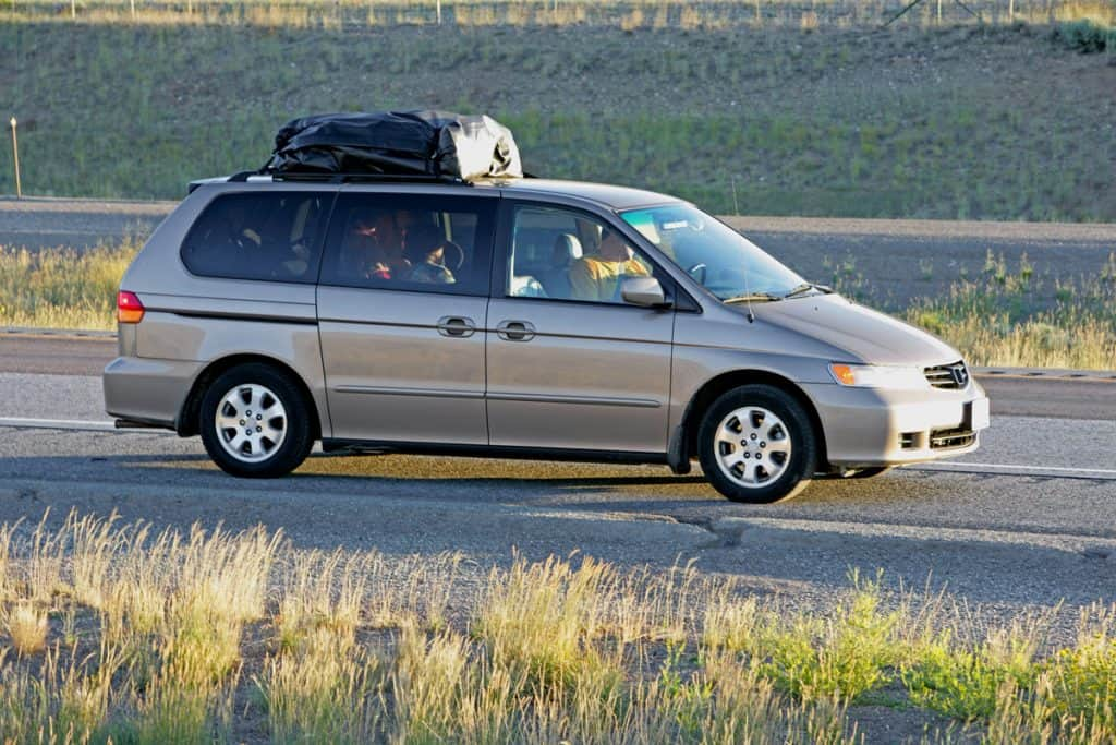 A minivan moving down the road