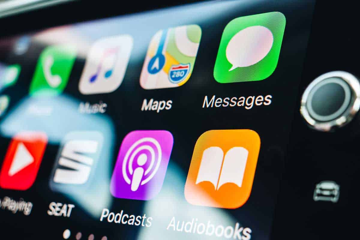 Details of App and icons on the the Apple CarPlay main screen in modern car dashboard during driving Mapos, music and Podcasts