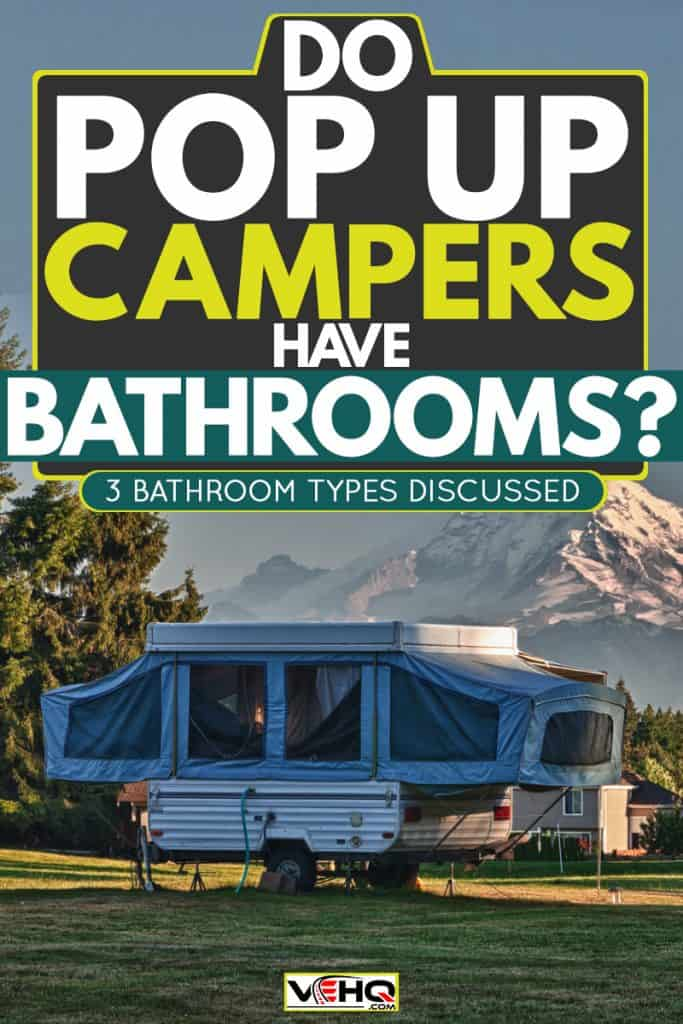 A pop-up camper already set up for camping at a camp site with a panoramic view of Mount Rainier, Do Pop Up Campers Have Bathrooms? [3 Bathroom Types Discussed]