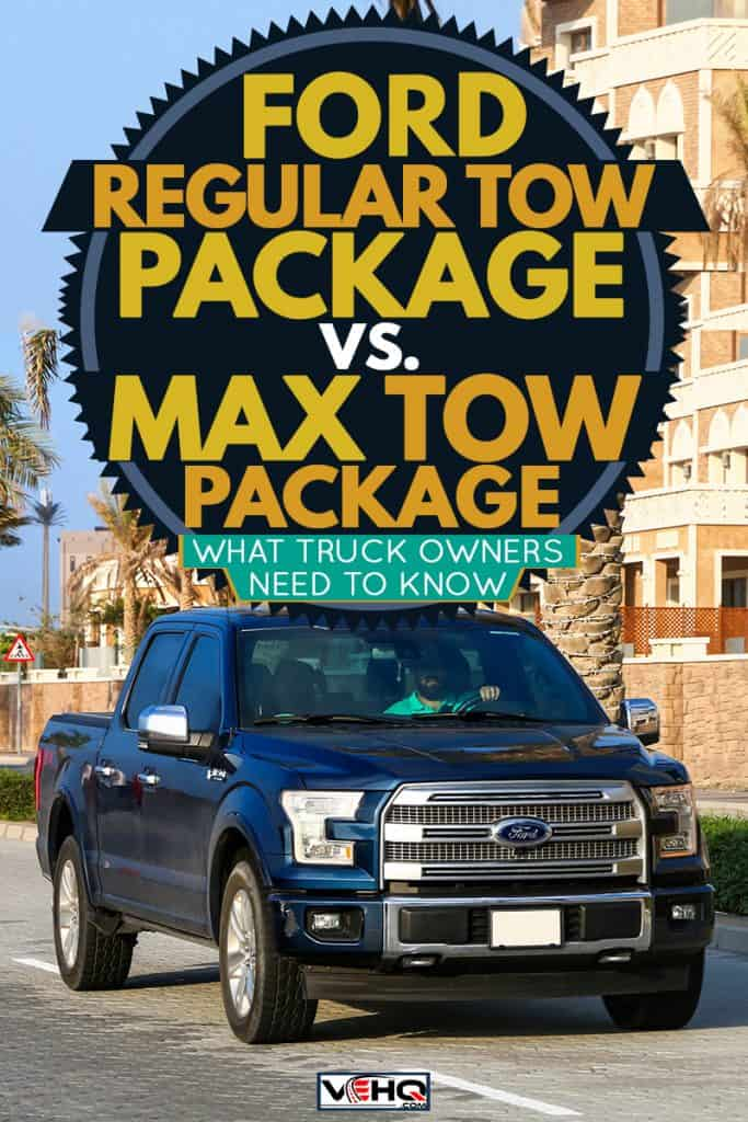 A dark blue colored Ford F-150 moving down the road with a person driving it, Ford Regular Tow Package vs Max Tow Package - What Truck Owners Need To Know