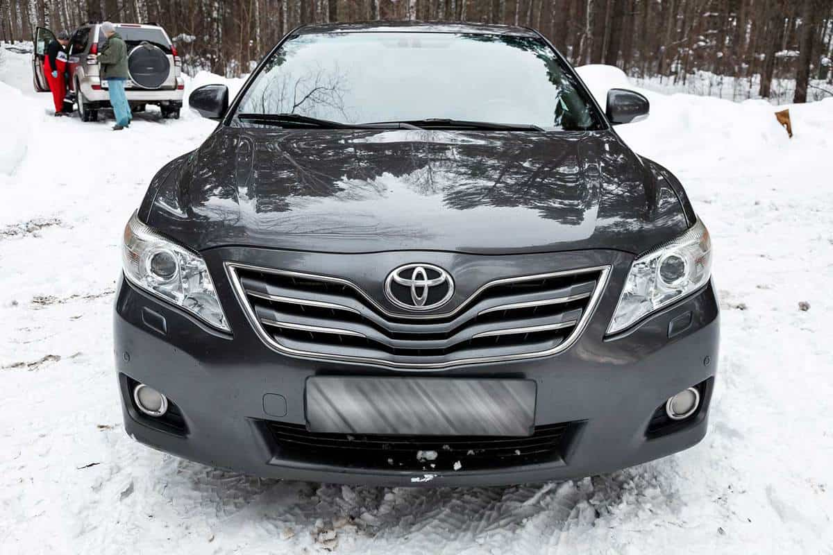 Front view of Toyota Camry on a snowy road