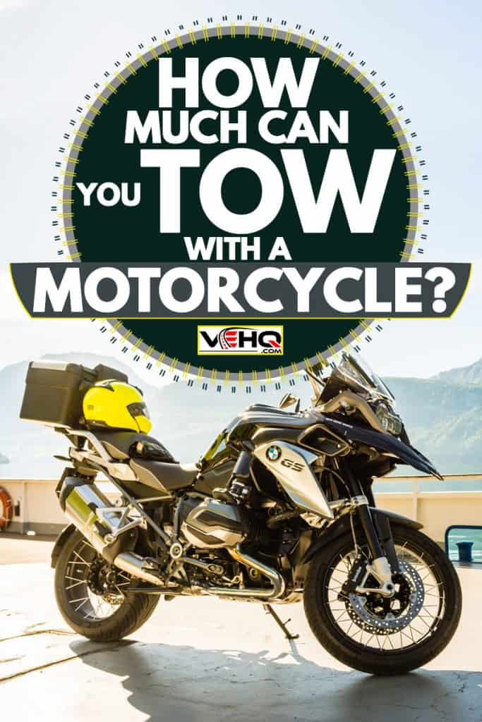A BMW GS 1250 parked on the side of the road with a panoramic view of the mountains, How Much Can You Tow With A Motorcycle?