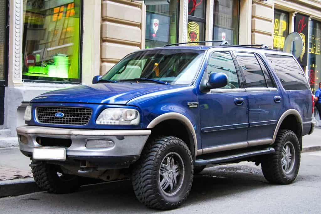 Offroad motor car Ford Expedition in the city street, What's the 3rd Row Legroom in a Ford Expedition?