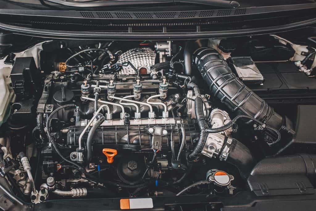 Open hood on diesel engine modern car