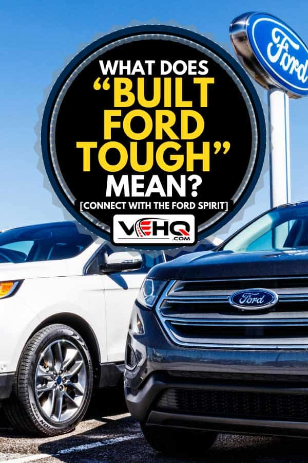 "Ford trucks under ford sign in a ford car and truck dealership, What Does ""Built Ford Tough"" Mean? [Connect with the Ford Spirit]"