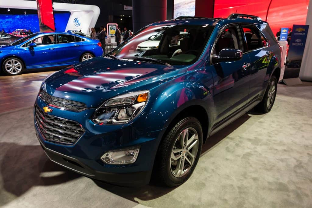 A blue Chevy Equinox at a car show, Can I Flat Tow a Chevy Equinox? [Here's How To]