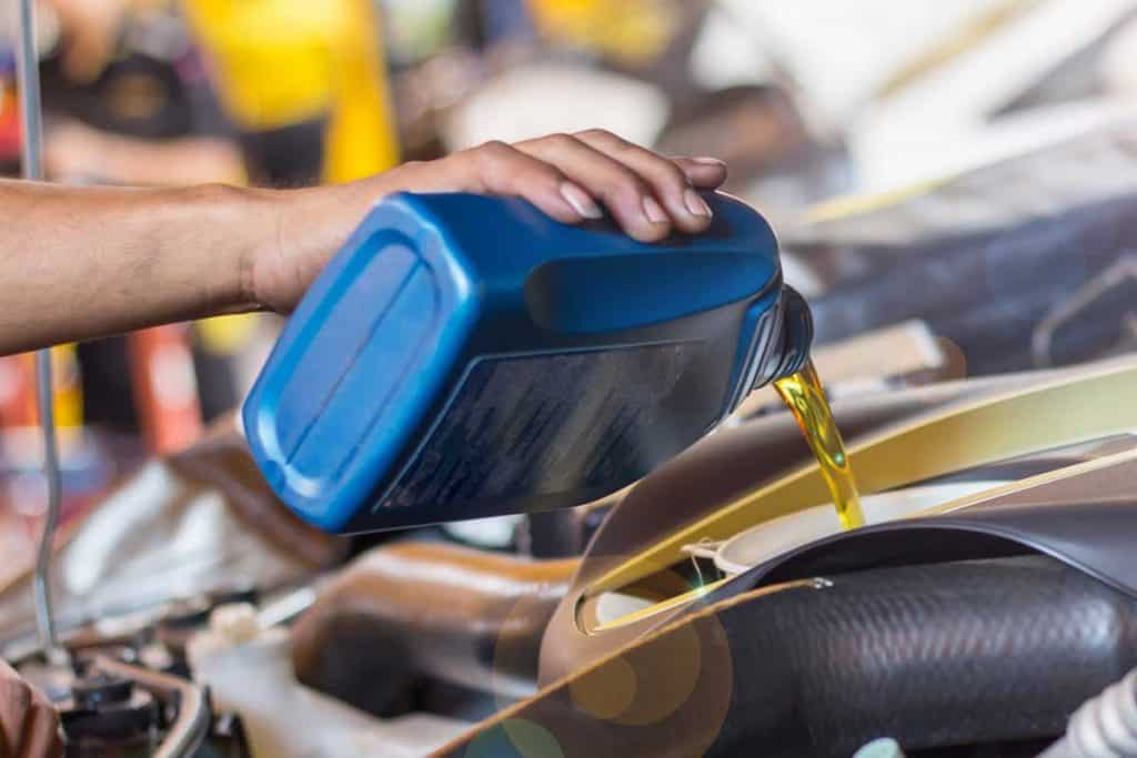 A man pouring oil to car engine, Does Castrol Motor Oil Contain Zinc?