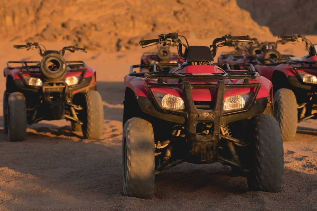 ATVs parked in sunrise morning in the desert, ATV Has Spark And Fuel But Won't Start - What Could Be Wrong?