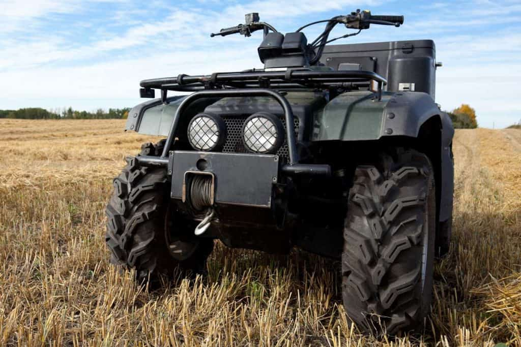 An all terrain vehicle in a farmers harvested field, How To Keep ATV Tires From Going Flat?