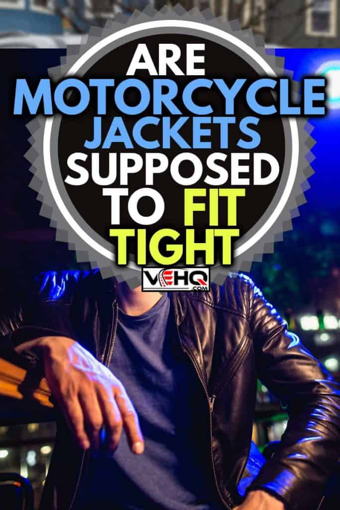 Handsome man in leather jacket with sunglasses and neon lights, Are Motorcycle Jackets Supposed To Fit Tight?