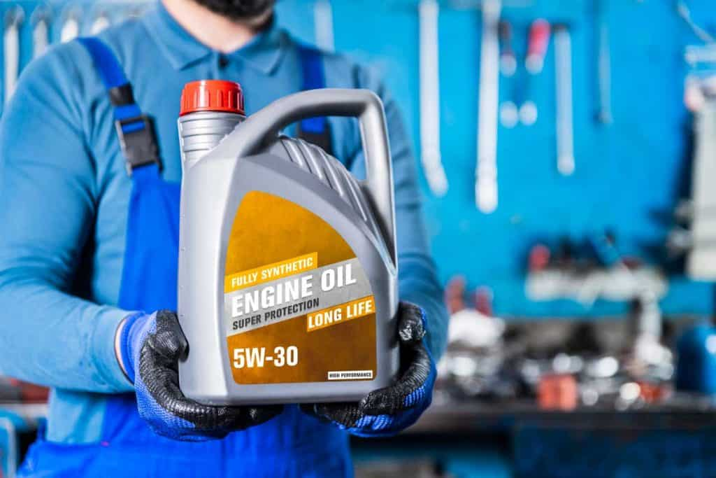Auto Repair Shop, Auto Mechanic Showing Motor Oil,