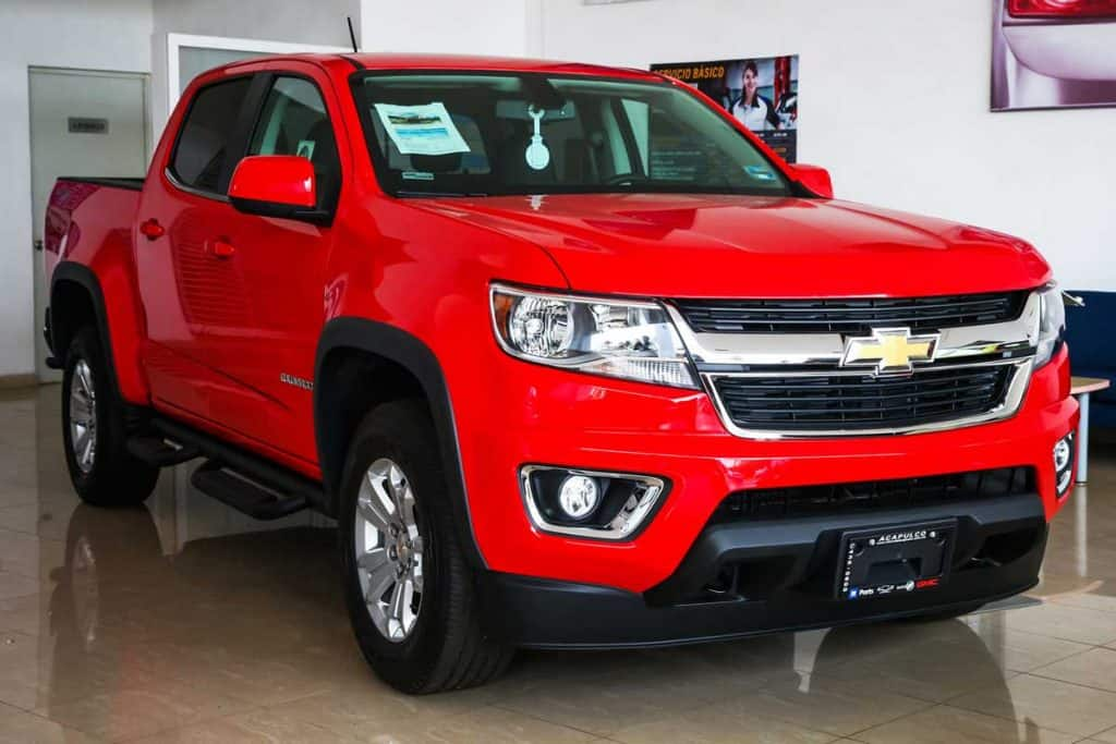 Brand new pickup truck Chevrolet Colorado in a car dealership, How Much Can You Tow with a Chevy Colorado?