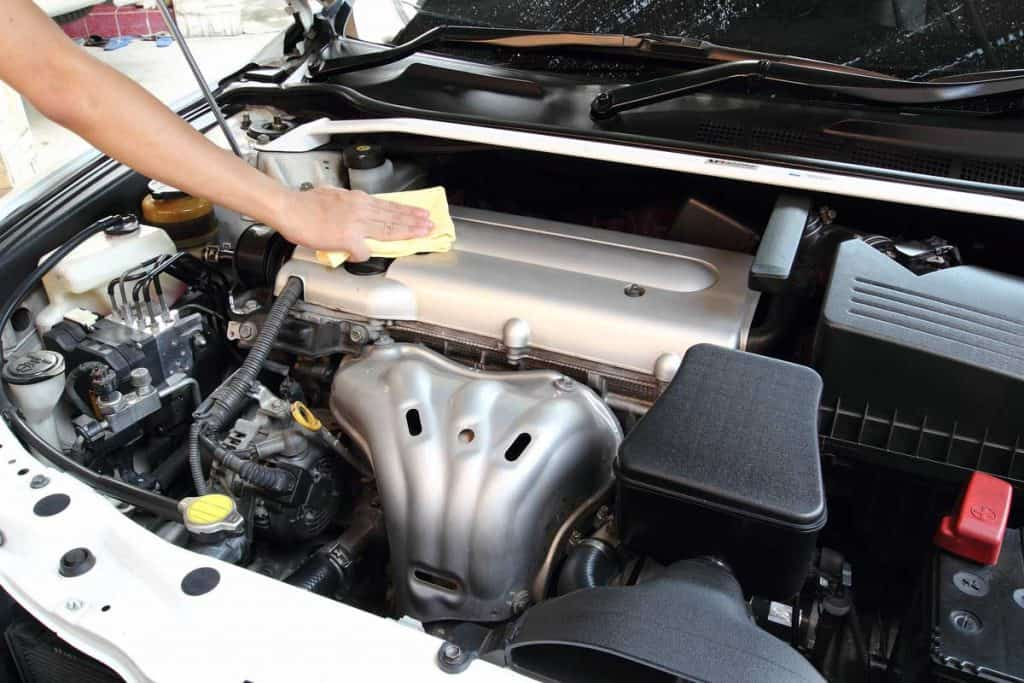 Car service cleaner wipe the car engine