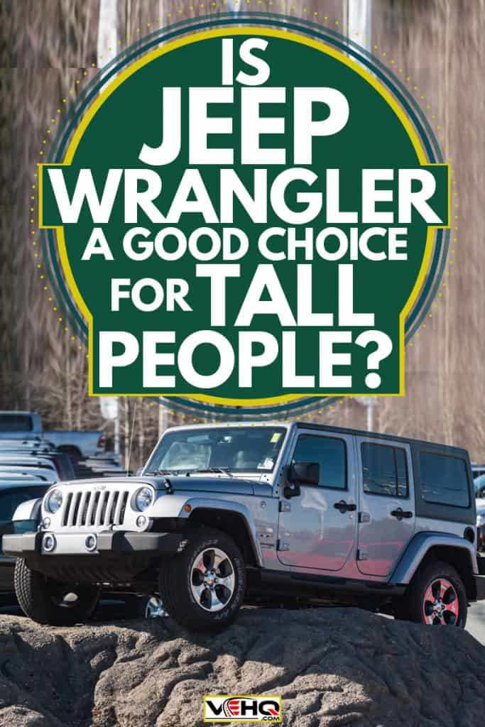 A Jeep Wrangler parked on top of a huge rock, Is Jeep Wrangler A Good Choice For Tall People?