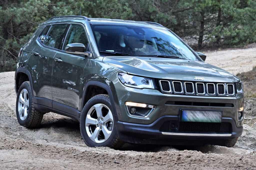 Jeep Compass SUV parked on the sandy road, Does Jeep Compass Have 4-Wheel-Drive Or All Wheel Drive?