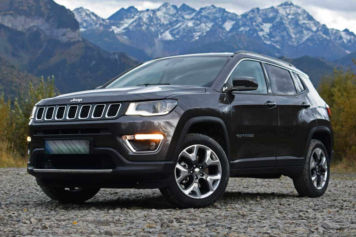 Jeep Compass parked on the mountain roads, Does Jeep Compass Come With Spare Tire?