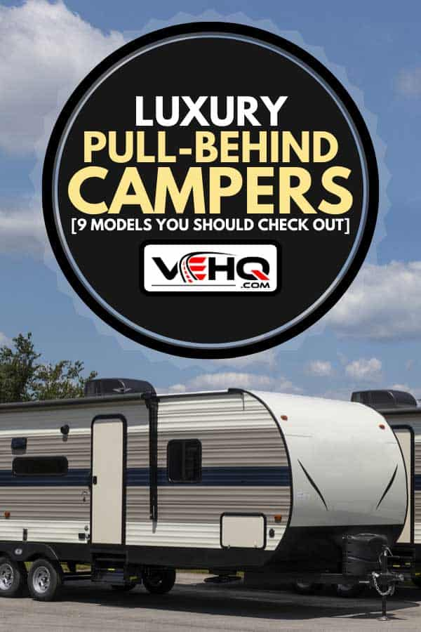 Luxury motorhome parked in a sunny day, Luxury Pull-Behind Campers [9 Models You Should Check Out]