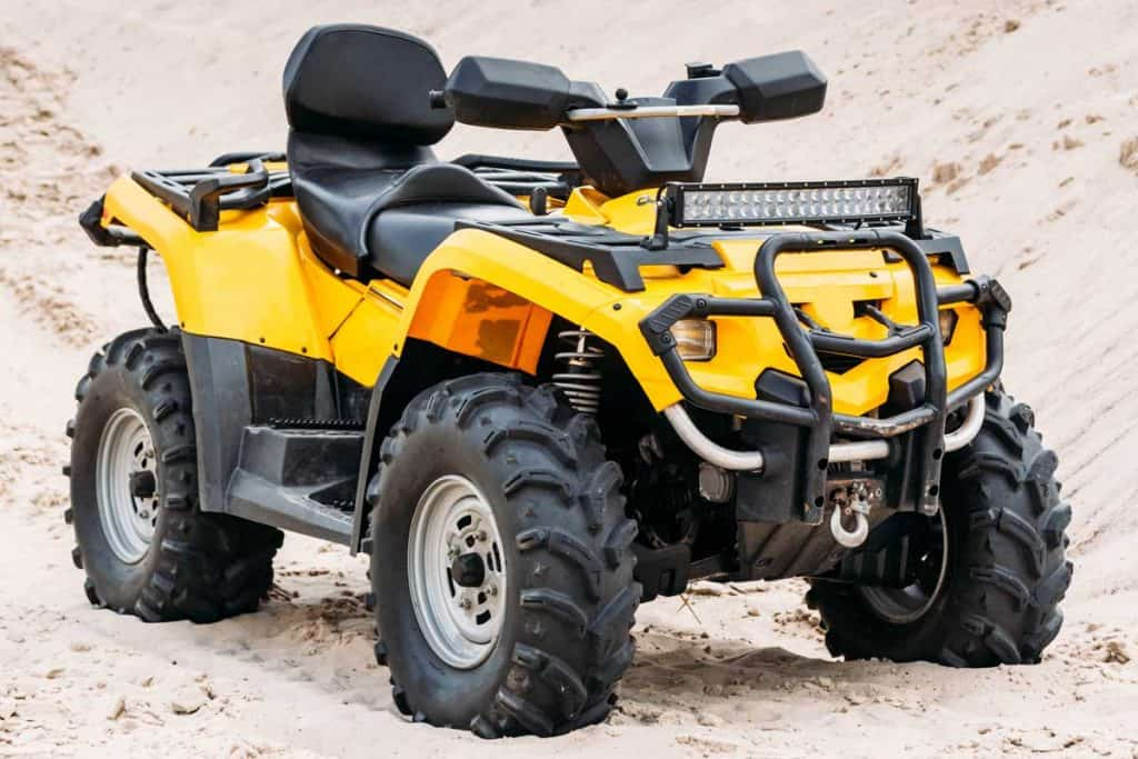 Modern yellow all-terrain vehicle standing in desert, How Much Does An Arctic Cat ATV Cost?
