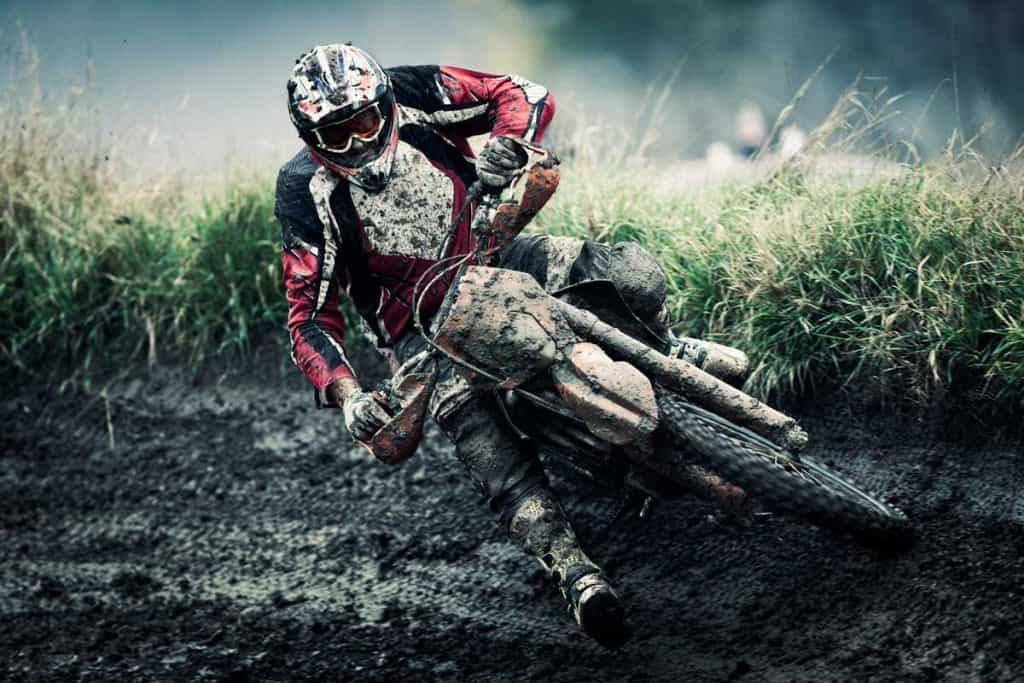 Motocross rider on track, strong grain added to create atmosphere