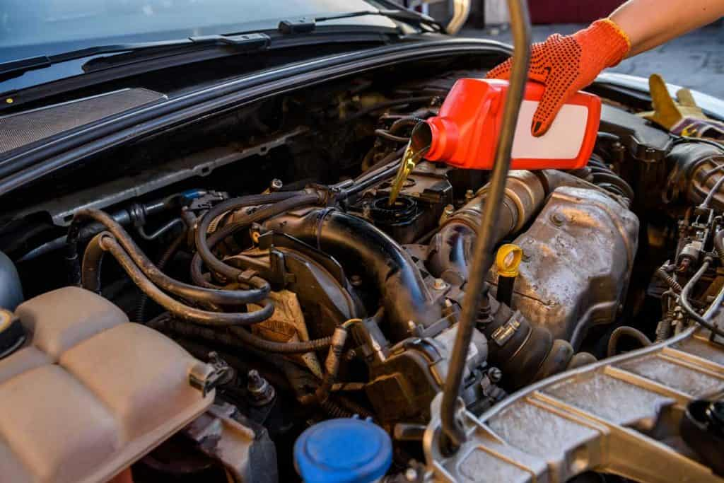 Oil change in car service., 5 Engine Oil Treatment Benefits Every Car Owner Should Know