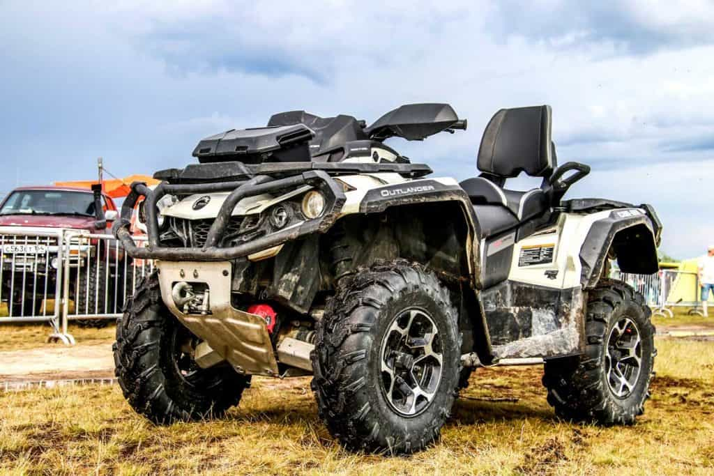 Quad bike Can-Am BRP Outlander is parked at the countryside, How Long Is An ATV?