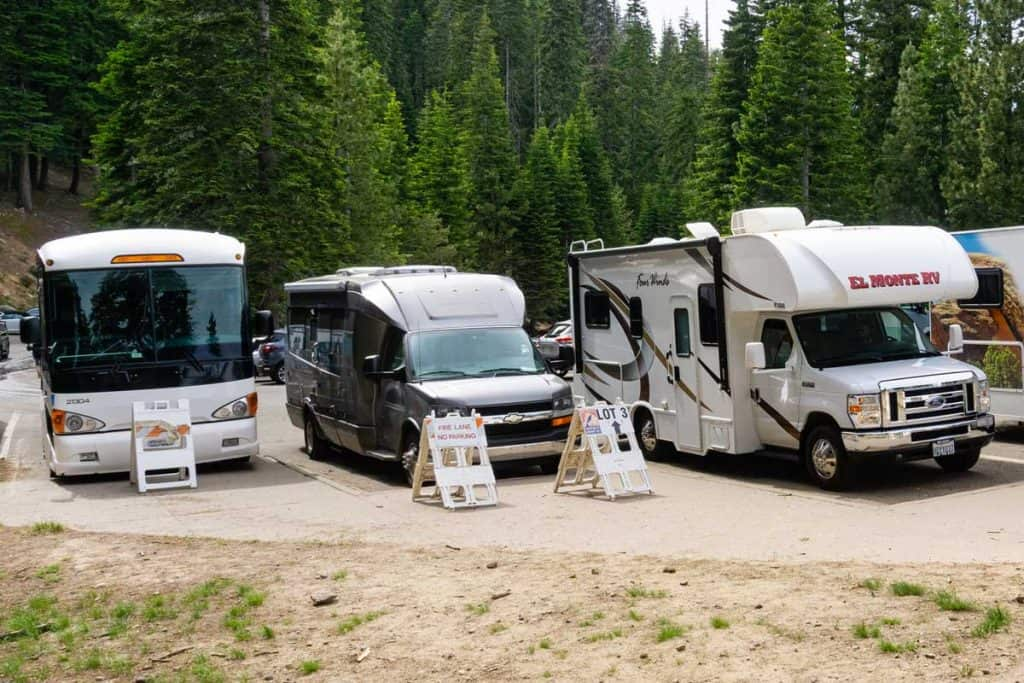 RV parking lot area with class a, b, and c motorhomes, What's the Difference Between Class A, B, and C Motorhomes?