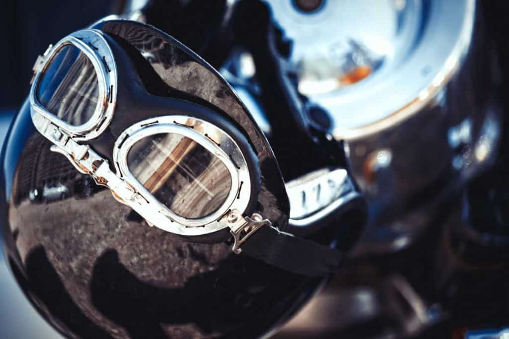 Vintage motorcycle helmet placed on a motorbike - Motorcycle Transport Safety Detail Backgrounds