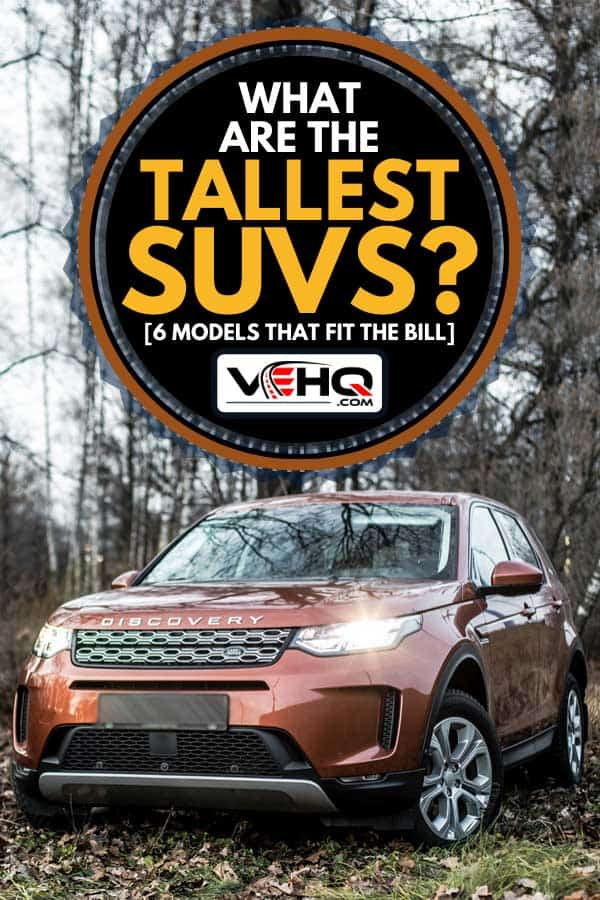 Land Rover Discovery sport parked in the forest, What Are The Tallest SUVs? [6 Models That Fit The Bill]