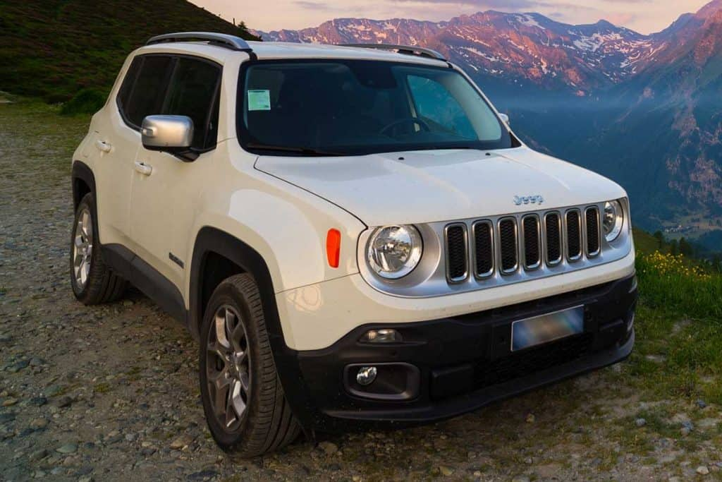 White Jeep Renegade parked on dirt road, Does Jeep Renegade Come With A Spare Tire?