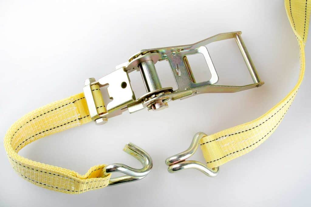 Yellow ratchet truck cargo tie downs on white background