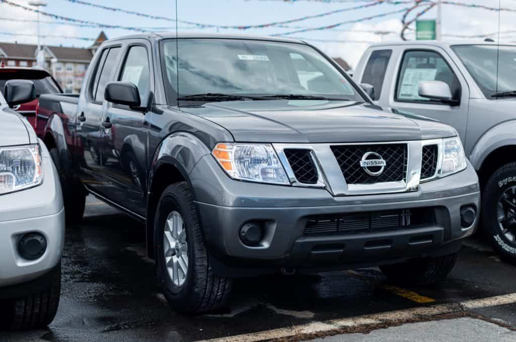 2020 nissan frontier parked in a car dealership
