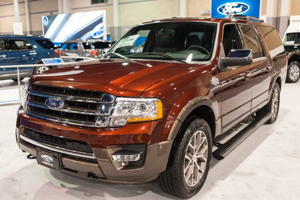 A brown colored Ford Expedition at a car show