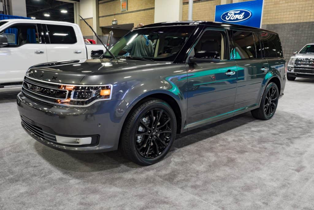A shimmering gray colored Ford Flex at a car show