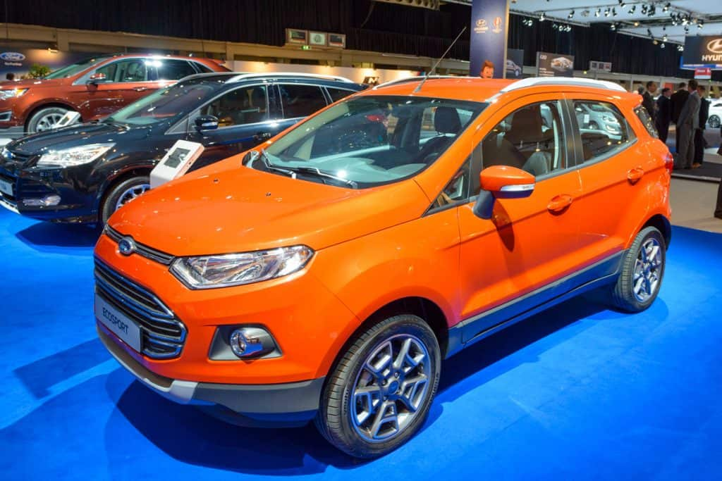 An orange colored Ford EcoSport at a car show