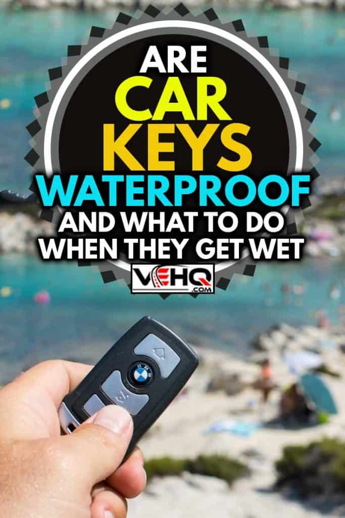 Photo shoot of BMW 750Li, closeup shot of a start car key in a male hand.In the background is blue sea and sandy beach, Are Car Keys Waterproof? [And what to do when they get wet]